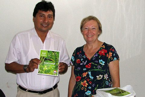 "The principal of the ""Augusto Durand"" school in Yuyapichis with the first edition of the Panguana brochure in Spanish language"